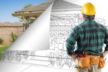 Townsville Carports construction worker building the blans for a new pergolas